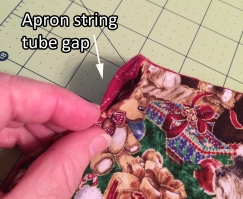 apron string tube gap