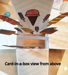 Card in a box view from above