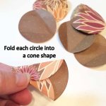 Fold each circle into a cone shape