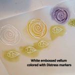 white embossed vellum colored with distress markers